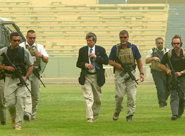 L. Paul Bremer, the U.S. civilian administrator of Iraq, arrives at al-Sha'ab stadium to congratulate the Iraqi soccer team in Baghdad, Iraq, Saturday May 15, 2004. Iraq's soccer team scored a surprising win over Saudi Arabia this week to seal a place for themselves in the forthcoming Athena Olympics. (AP Photo/Saurabh Das)
